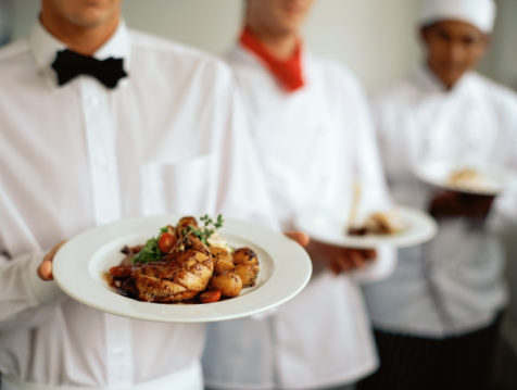 Waiters serving food