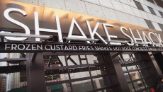 CHICAGO, IL - JANUARY 28:  A sign hangs outside of a Shake Shack restaurant on January 28, 2015 in Chicago, Illinois. The burger chain, with currently has 63 locations, is expected to go public this week with an IPO priced between $17 to $19 a share. The company will trade on the New York Stock Exchange under the ticker symbol SHAK. (Photo by Scott Olson/Getty Images)
