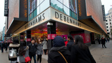 LONDON, ENGLAND - DECEMBER 26:  Shoppers walk outside Debenhams during the annual boxing day sales at Debenhams on December 26, 2014 in London, England.  (Photo by Ben A. Pruchnie/Getty Images)