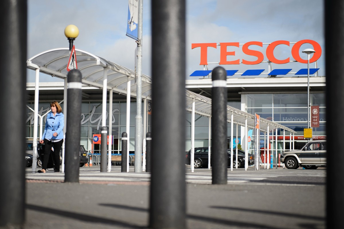 A Tesco supermarket is pictured in north London, on August 29, 2014. British supermarket giant Tesco on Friday issued another profits warning and slashed its shareholder dividend by 75 percent, blaming challenging trade and high investment costs. AFP PHOTO/Leon Neal        (Photo credit should read LEON NEAL/AFP/Getty Images)