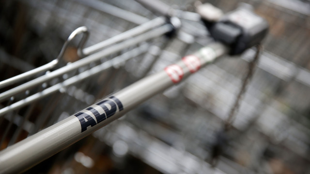 LONDON, ENGLAND - SEPTEMBER 29: Logos adorn trollies outside an Aldi supermarket on Old Kent Road on September 29, 2014 in London, England. Aldi has reported a 65% increase in profits, and is planning to open 65 new stores next year. (Photo by Matthew Lloyd/Getty Images)
