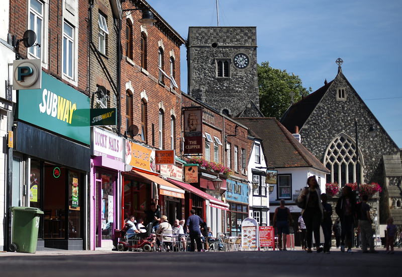 DARTFORD, ENGLAND - SEPTEMBER 02: Shops, cafes and a pub on the High Stret on September 2, 2013 in Dartford, England. High Street campaigner Mary Portas is today facing questions from Members of Parliament on the communities and local government select committee. The traditional high street is under increasing pressure due to the recession and the rise of on-line shopping.  (Photo by Peter Macdiarmid/Getty Images)