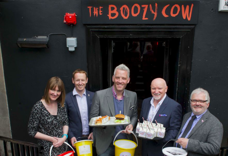 Representatives of VSA, CHAS, The Archie Foundation and the STV Appeal with Garreth Wood outside the Boozy Cow in Edinburgh