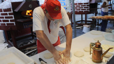 "One of a team of professional neapolitan pizza makers kneads dough to give away free pizza margheritas in Dante square in downtown Naples, on August 27, 2008.  Pizza chefs in Naples gave away more than 5,000 free pizzas to protest against restaurants that have ""unfairly"" hiked up the cost of a pizza amid rising global food prices. Sergio Miccu, president of the association of Neapolitan pizza chefs (ANP), accused restaurants and pizza chefs of increasing pizza prices to a level that is not justified by the cost of the basic ingredients.  AFP PHOTO / Roberto Salomone (Photo credit should read ROBERTO SALOMONE/AFP/Getty Images)"
