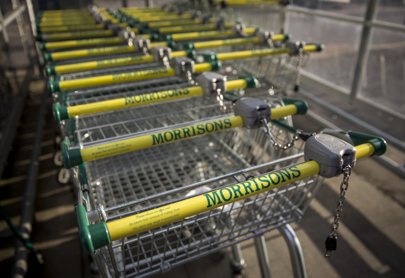 LONDON, ENGLAND - OCTOBER 02:  Morrisons logos adorn trolleys outside a branch of the supermarket chain on October 2, 2014 in London, England. Morrisons, who reported a fall in half-year profits of more than 30%, has today announced a new loyalty card scheme. Its Match & More card will award points equivalent to the difference in price on cheaper items in Aldi, Lidl, Tesco, Sainsbury's and Asda.  Photo by Rob Stothard/Getty Images)  (Photo by Rob Stothard/Getty Images)