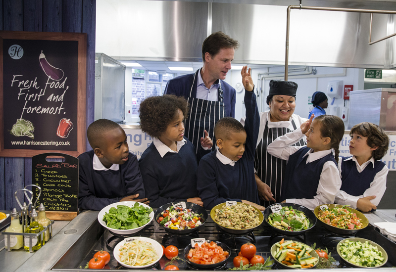 LONDON, ENGLAND - SEPTEMBER 02: Deputy Prime Minister Nick Clegg speaks with children about food on September 2, 2014 in London, England. The Deputy Prime Minister Nick Clegg took part in a photocall in conjunction with the launch of a £1 Billion GBP scheme designed to provide free hot school meals for primary school pupils in England. (Photo by Dan Kitwood/Getty Images)