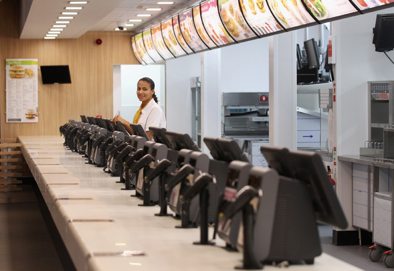 LONDON, ENGLAND - JUNE 25:  Assistant manager Rachel Lucien stands at the checkouts in the world's largest McDonald's restaurant which is their flagship outlet in the Olympic Park on June 25, 2012 in London, England. The restaurant, which is one of four McDonald's to be situated within the Olympic Park, will have a staff of 500. After the Olympic and Paralympic Games conclude the restaurant will be dismantled and all fixtures and fittings will be either reused or recycled.  (Photo by Oli Scarff/Getty Images)
