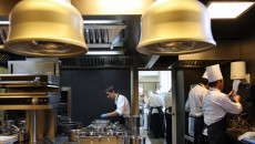 """Employees of """"El Celler de Can Roca"""" work in the restaurant's kitchen in Girona on April 30, 2013. Spain's El Celler de Can Roca seized the title of the world's best restaurant from Denmark's Noma on April 29, one month after dozens of people came down with a bout of food poisoning from the Copenhagen eatery. The restaurant in Girona, run by three brothers and known for its dishes based on perfumes, had spent two years as runner-up on the World's 50 Best Restaurants list compiled for a 12th year by more than 900 international experts for Britain's Restaurant magazine.  AFP PHOTO / QUIQUE GARCIA        (Photo credit should read QUIQUE GARCIA/AFP/Getty Images)"""
