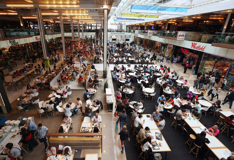 STRATFORD, ENGLAND - JULY 31:  Members of the public dine in the food court of the giant Westfield Stratford shopping mall adjacent to the Olympic Park on July 31, 2012 in London, England. Trading in the huge 1.9 million sq ft mall has been boosted by the footfall of spectators, volunteers and competitors from the Olympic Park; whilst shops and restaurants in London's West End are reporting up to 70% declines in revenue.  (Photo by Oli Scarff/Getty Images)