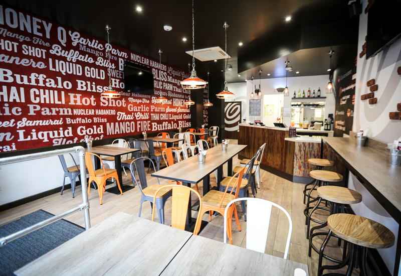 High-flying US fast food chain Wing Zone has launched its first store in the UK.