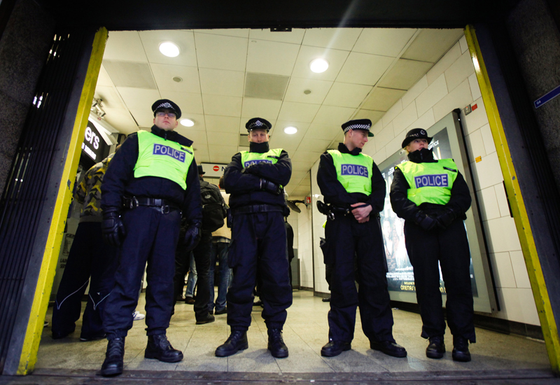 LONDON, ENGLAND - JANUARY 26: Members of the Metropolitan Police close off Holborn Tube Station on January 26, 2014 in London, England. The far-right nationalist party; Jobbik ('Movement for a Better Hungary') had planned to hold a public meeting in the Holborn area of London, but were forced to move the meeting to Hyde Park following clashes with Anti-Fascist crowds. (Photo by Dan Dennison/Getty Images)