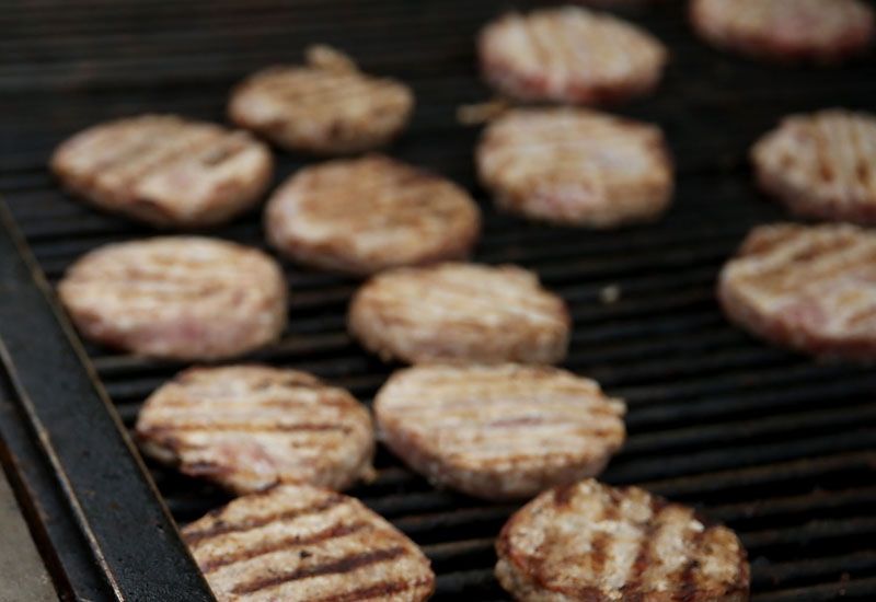 DES MOINES, IA - AUGUST 17:  A CNN microphone records audio of pork burgers cooking on the grill at the Iowa Pork Producers Pork Tent during the Iowa State Fair on August 17, 2015 in Des Moines, Iowa.  Presidential candidates are addressing attendees at the Iowa State Fair on the Des Moines Register Presidential Soapbox stage and touring the fairgrounds. The State Fair runs through August 23.  (Photo by Justin Sullivan/Getty Images)