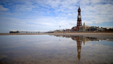 BLACKPOOL, ENGLAND - AUGUST 15: A general view of Blackpool Tower and beach where visitor numbers have been the highest in decades, according to the #Blackpoolsback campaign on August 15, 2014 in Blackpool, England. A giant beach ball measuring a height of 16.6 meters was earlier inflated beating the previous world record of 15.8 meters to mark the #Blackpoolsback campaign. (Photo by Christopher Furlong/Getty Images)