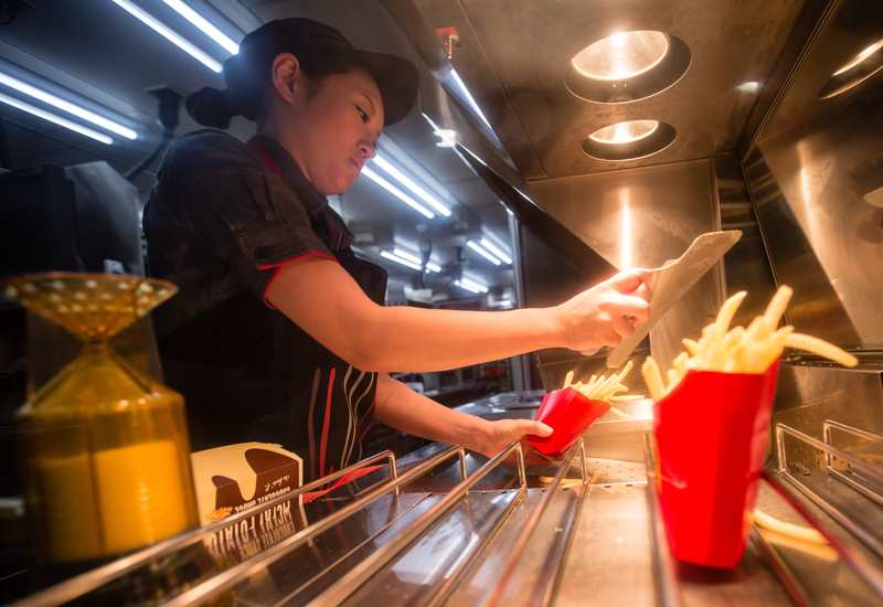 TOKYO, JAPAN - JANUARY 25:  McDonald's Japan Swing Manager Miwa Suzuki prepares french fries to be used for McChoco Potato on January 25, 2016 in Tokyo, Japan. The McChoco Potato, McDonald's Japan's special winter menu, french fries covered in chocolate and white chocolate sauces will be available in McDonald's restaurants on January 26, 2016 until around mid February.  (Photo by Christopher Jue/Getty Images)