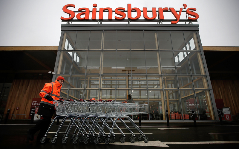 KING'S LYNN, ENGLAND - NOVEMBER 21:  A colleague moves trolleys in the car park of Sainsbury's new Kings Lynn supermarket, one of the retailer's most energy efficient stores on 21 November in Kings Lynn, England. The 72,000sq ft store has created over 400 new jobs for local people and opens on the day Sainsbury's reveals findings that shopping lists, better meal planning and rising expectations signal new fashioned values of post-crunch shoppers.  (Photo by Matthew Lloyd/Matthew Lloyd/getty Images for Sainsbury's)