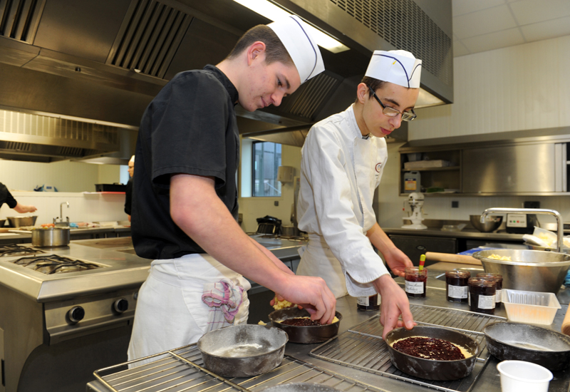 Apprentice chefs prepare a dessert at the Apprentice Training Center (CFA) of the Campus des Metiers (Job Campus) in Quimper, western France, on February 24, 2016.  / AFP / FRED TANNEAU        (Photo credit should read FRED TANNEAU/AFP/Getty Images)