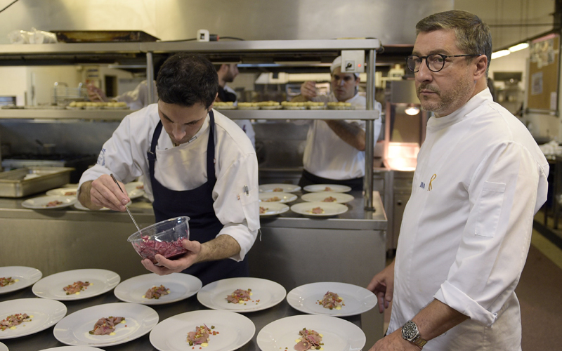 "One of the owners of Spanish restaurant ""El Celler de Can Roca"", chef Joan Roca (2R) supervises the preparation of a dish at the kitchen of the Terrazas Bistro restaurant during a dinner of ""The Cooking Tour Experience 2015"" in Buenos Aires on August 6, 2015. ""El Celler de Can Roca"" is the best restaurant in the world according to the British magazine ""Restaurant"" and it has gotten three Michelin stars. During the tour the Roca brothers will visit also Miami, Houston, Birmingham and Istanbul. AFP PHOTO / JUAN MABROMATA        (Photo credit should read JUAN MABROMATA/AFP/Getty Images)"