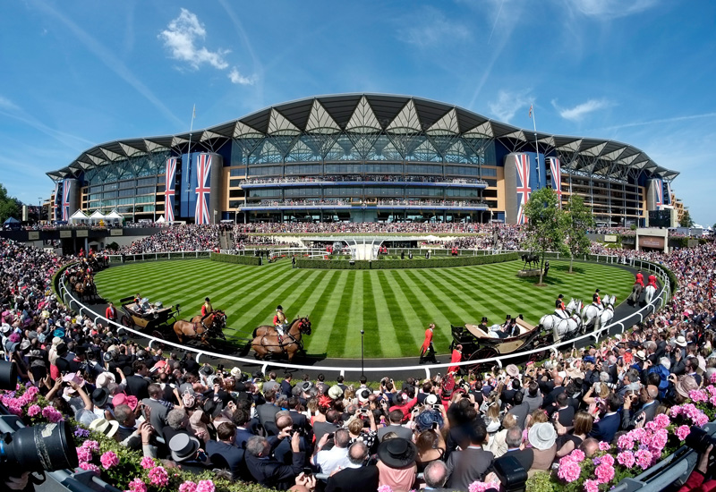 ASCOT, ENGLAND - JUNE 17:  A general view of the Grandstand during the Royal Procession on day one of Royal Ascot at Ascot Racecourse on June 17, 2014 in Ascot, England.  (Photo by Alan Crowhurst/Getty Images for Ascot Racecourse)
