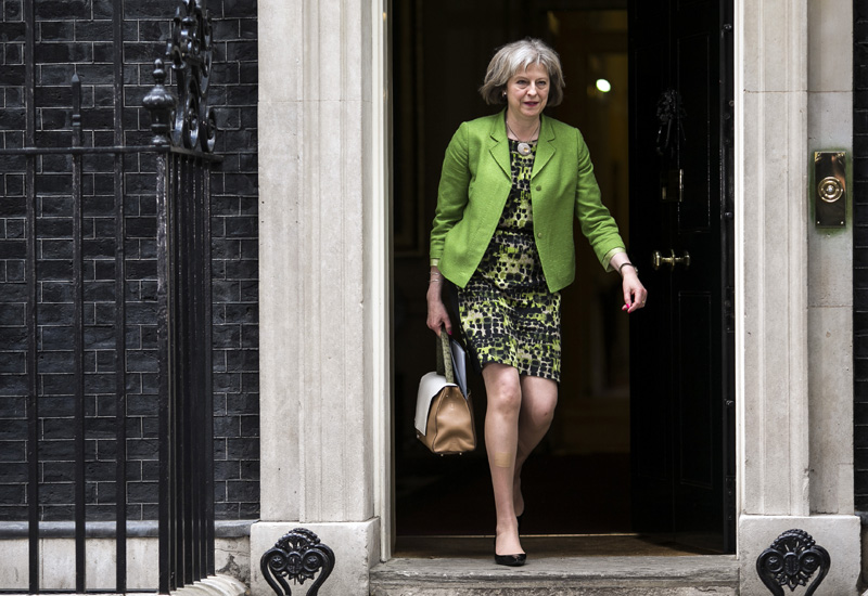 LONDON, ENGLAND - MAY 12: British Home Secretary Theresa May leaves after the first weekly cabinet meeting in Downing Street, on May 12, 2015 in London, England. Conservative party Prime Minister David Cameron has unveiled his new cabinet after claiming an election victory last week that gave his party an outright majority in parliament, the first time in nearly 20 years.  (Photo by Dan Kitwood/Getty Images)