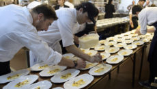 "One of the owners of Spanish restaurant ""El Celler de Can Roca"", patissier Jordi Roca(L) supervises the preparation of a dish at the kitchen of the Terrazas Bistro restaurant during a dinner of ""The Cooking Tour Experience 2015"" in Buenos Aires on August 6, 2015. ""El Celler de Can Roca"" is the best restaurant in the world according to the British magazine ""Restaurant"" and it has gotten three Michelin stars. During the tour the Roca brothers will visit also Miami, Houston, Birmingham and Istanbul.  AFP PHOTO / JUAN MABROMATA        (Photo credit should read JUAN MABROMATA/AFP/Getty Images)"