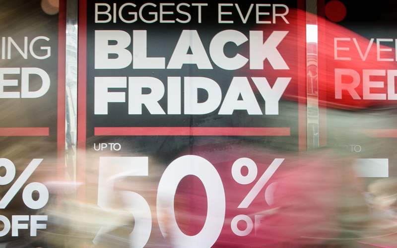 """Retail stores display """"Black Friday"""" advertisements and banners on Oxford Street in central London, as the annual retail event takes place on November 27, 2015. Black Friday, is a sales offer originating from the US where retailers slash prices on the day after the Thanksgiving holiday. Early indications suggest that online sales have faired better than retail stores.  AFP PHOTO / LEON NEAL / AFP / LEON NEAL        (Photo credit should read LEON NEAL/AFP/Getty Images)"""
