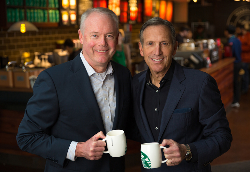 Kevin Johnson, Starbucks president and chief operating officer, is shown with Howard Schultz, chairman and chief executive officer in a Starbucks store at the corporate headquarters in Seattle. Photographed on Thursday, December 1, 2016.   (photo by Joshua Trujillo, Starbucks)