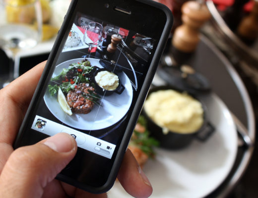 """TO GOWITH AFP STORY BY Karine ALBERTAZZI et Isabelle TOUSSAINT  A man takes a picture of his meal with his mobile phone to share it on the """"Food Reporters"""" network on July 19, 2012 during his lunch in a restaurant in Paris. """"Food Reporters"""" is a culinary social network accessible via a smartphone application and a website.  AFP PHOTO / ANA AREVALO        (Photo credit should read ANA AREVALO/AFP/Getty Images)"""