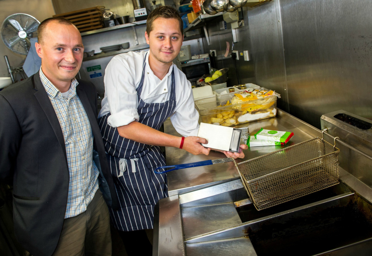 © Licensed to simonjacobs.com. 09/07/2014 London, UK. Kyle Barnes, head chef of The Eagle, right and Sam Wilbraham, Marketing Director and Executive Chef  for Hull based PriFura who produce a small ceramic block for use by commercial kitchens using large quantities of cooking oil. The product sits in the bottom of fryers and doubles the life of deep fat fryer oil. Photo credit: Simon Jacobs.