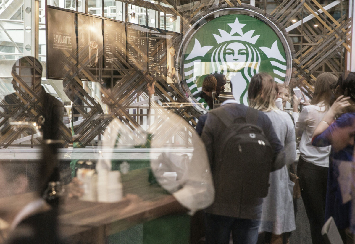 Hundreds of people queue during the official opening of South Africa's first Starbucks store, also the US coffeehouse chain's first store in Sub-Saharan Africa, in Johannesburg on April 21, 2016. / AFP / GIANLUIGI GUERCIA        (Photo credit should read GIANLUIGI GUERCIA/AFP/Getty Images)