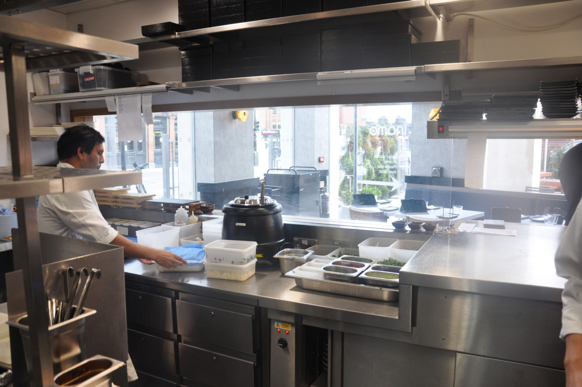 Inamo's glass kitchen brings walk-in business and reassures customers of freshley prepared food.