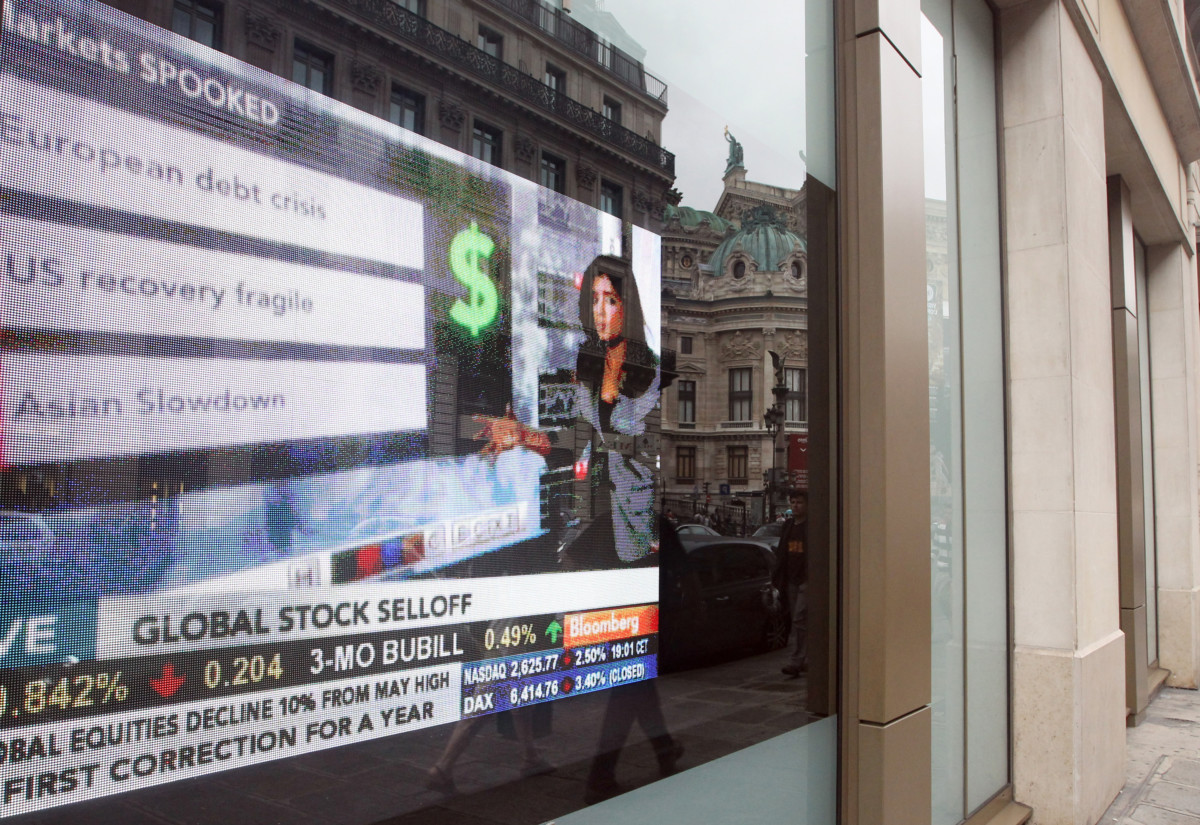 A picture taken on August 4, 2011 in Paris, shows a screen displaying stock  value indicators  at the entrance of the Bloomberg media company, which specialized in financial and economic news,.  ECB emergency response teams shifted into gear today with eurozone bond purchases and a fresh splash of unlimited loans to fight a widening debt crisis.