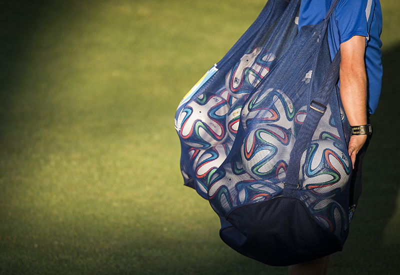 A Brazilian support team member arrives with the balls for a training session at the President Vargas stadium on the eve of the FIFA World Cup 2014 quarter-final match between Brazil and Colombia in Fortaleza on July 3, 2014.  AFP PHOTO / ODD ANDERSEN        (Photo credit should read ODD ANDERSEN/AFP/Getty Images)