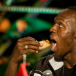 "World and Olympic sprint champion Jamaican Usain Bolt eats a Mexican ""Taco"", during a conference at the World Sport Congress in Mexico city, on November 14, 2009. The triple Olympic and world sprint champion is in Mexico for a one-day visit. AFP PHOTO/Ronaldo Schemidt (Photo credit should read Ronaldo Schemidt/AFP/Getty Images)"