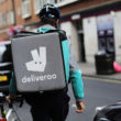 LONDON, ENGLAND - JULY 11:  A Deliveroo rider cycles through central London on July 11, 2017 in London, England. A recent government review looking at the 'Gig Economy', the 'Taylor Review' has suggested that all work in U.K. should be fair. Deliveroo's co-founder and CEO, Will Shu has said that his company will pay additional benefits to its 15,000 UK riders if the laws change.  (Photo by Dan Kitwood/Getty Images)