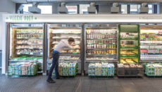 Team member stocking fridges at Veggie Pret, Shoreditch