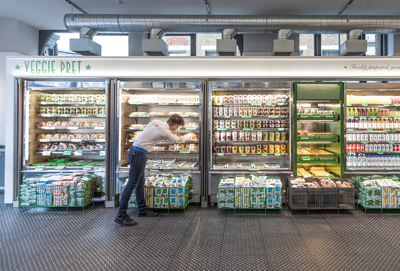 Team member stocking fridges at Veggie Pret, Shoreditch