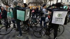 "Deliveroo's workers and other ""uberised"" bike messengers take part in a demonstration in Bordeaux, southwestern France, on March 15, 2017 on the day of a negotiation between Uber and VTC drivers (transport car with driver) regarding rates. / AFP PHOTO / GEORGES GOBET        (Photo credit should read GEORGES GOBET/AFP/Getty Images)"