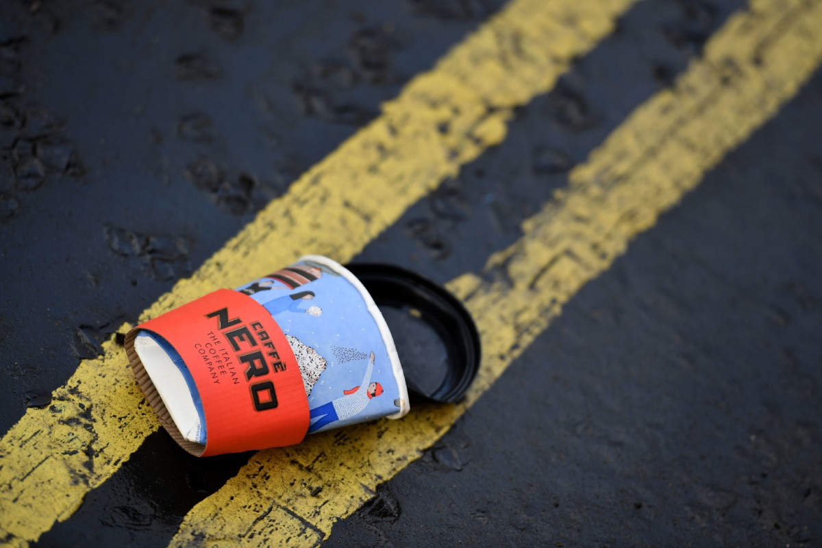 A flattened disposable coffee cup sits on a road in central London on January 5, 2018.  British lawmakers called on the government today to impose a charge on disposable coffee cups and set a target to recycle all of them by 2023 -- or ban them altogether. / AFP PHOTO / BEN STANSALL        (Photo credit should read BEN STANSALL/AFP/Getty Images)