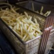 TOKYO, JAPAN - JANUARY 25:  A basket of french fries which will be used for McChoco Potato is seen in the kitchen at a McDonald's Japan branch on January 25, 2016 in Tokyo, Japan. The McChoco Potato, McDonald's Japan's special winter menu, french fries covered in chocolate and white chocolate sauces will be available in McDonald's restaurants on January 26, 2016 until around mid February.  (Photo by Christopher Jue/Getty Images)