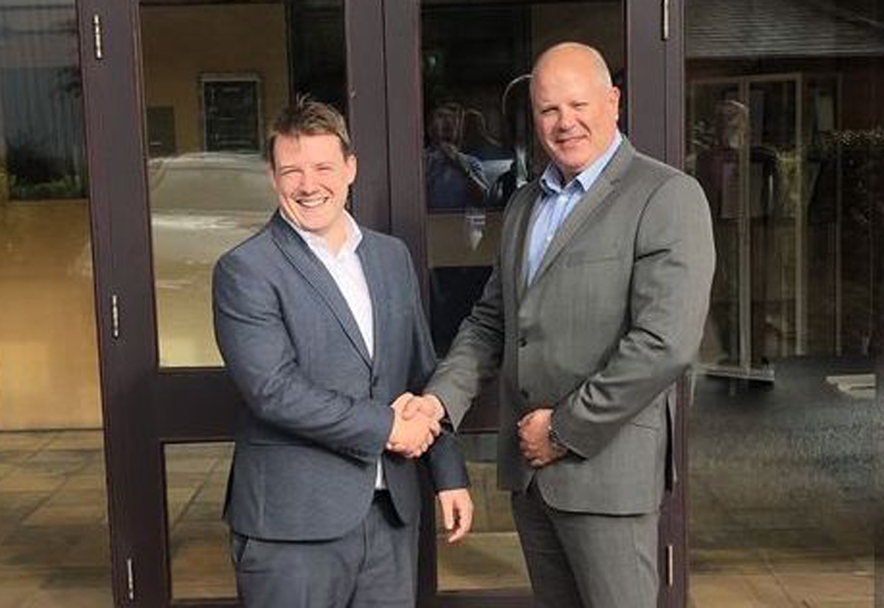 Andrew Bennett, area sales manager, and Robert Wager, general sales manager